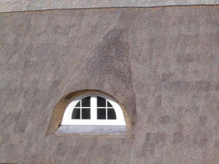 Eyebrow window thatched roof