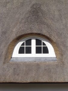 Thatched roof windows